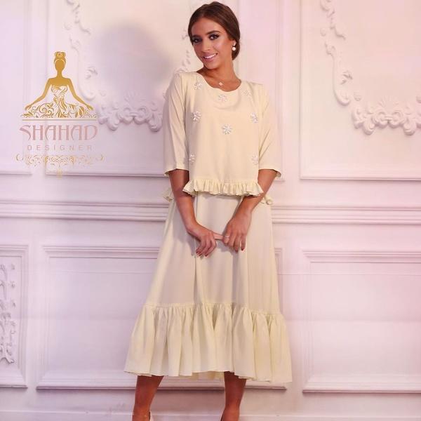 شهد الجمعة - مصمّمة أزياء